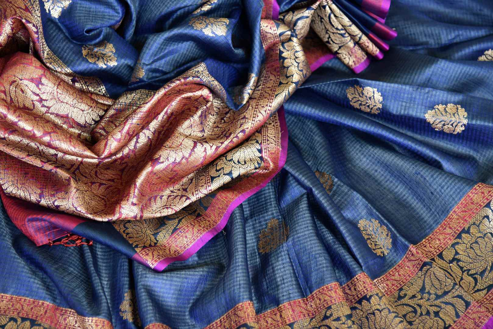Swing in the gorgeous traditional royal blue tussar banarsi silk sari. It comes with a designer zari border and a contrasting pink designer blouse to steal the show. The buta work all over the sari exudes flamboyance of a kind. Shop designer silk sari, printed saree online or visit Pure Elegance store, USA.-details