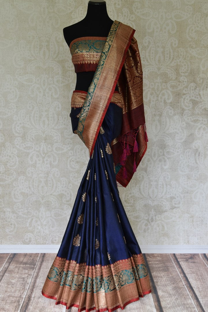Buy navy blue tussar Banarasi saree online in USA with zari border and buta. Add elegance to your Indian wedding look with this exquisite Indian Banarasi sari available at Pure Elegance exclusive Indian clothing store in USA or browse through our website and shop online.-full view