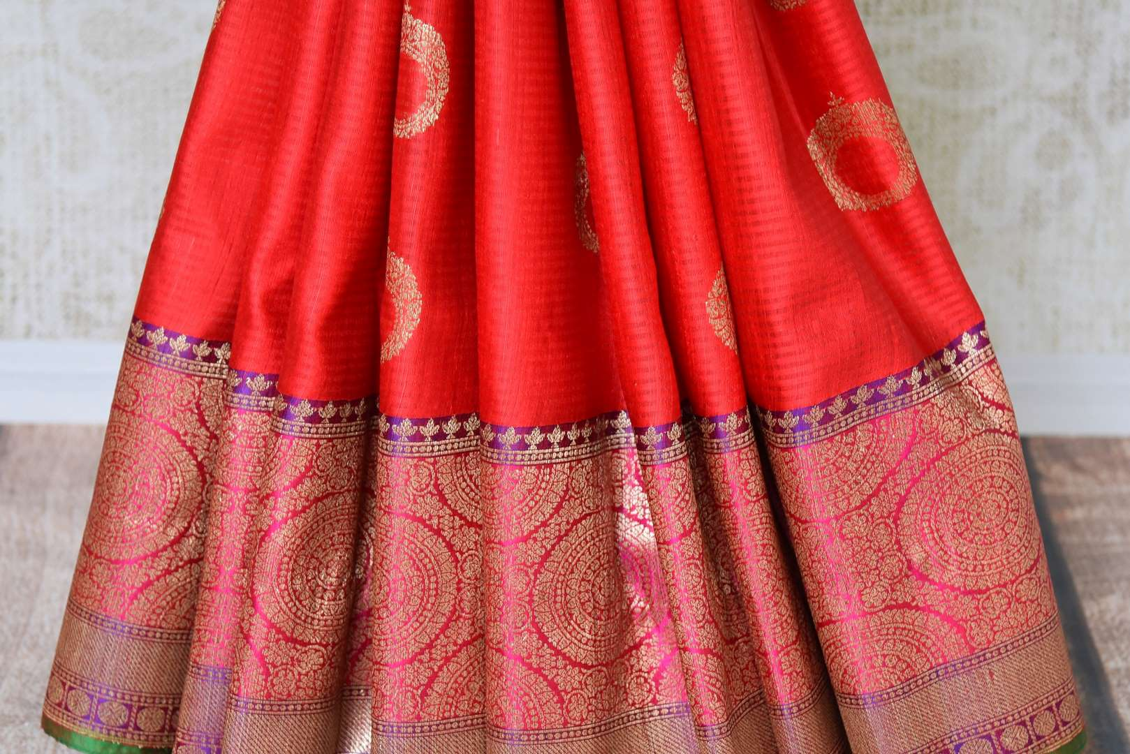 Buy bright red tussar Banarasi saree with rich zari border online in USA. Bring richness to your ethnic style with exquisite Indian sarees, traditional Banarasi sarees, silk saris from Pure Elegance Indian fashion store in USA or shop online.-pleats