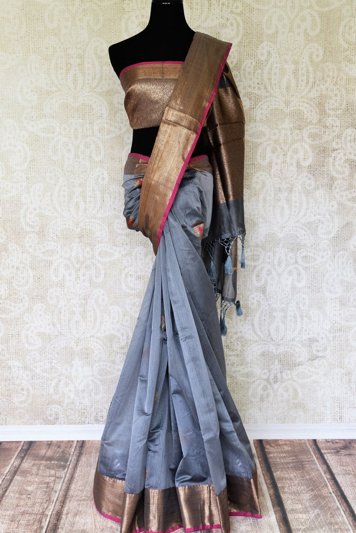 Strike a lasting impression in this designer grey chanderi silk saree. The delicate gold zari weave on the border and extending to the pallu personifies elegance at par. Style this sari with contrasting dull gold zari weave blouse. Shop designer handcrafted silk saris online or visit Pure Elegance store, USA.-full view