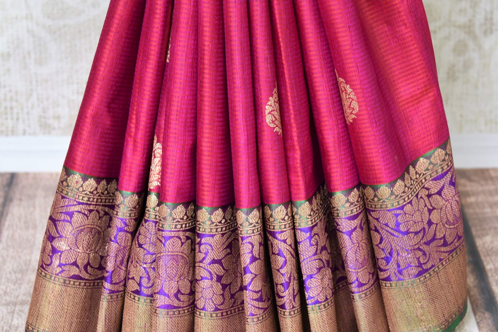 Shop alluring pink tussar Banarasi saree with rich zari border online in USA. Bring richness to your ethnic style with exquisite Indian saris, traditional Banarasi sarees, silk saris from Pure Elegance Indian fashion store in USA or shop online.-pleats