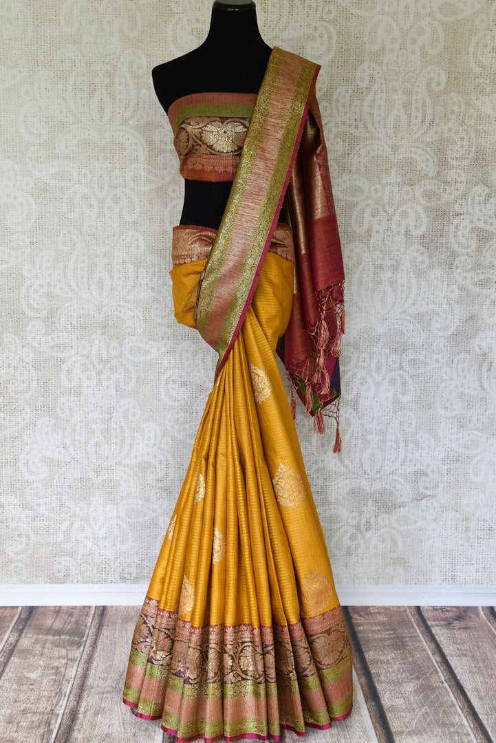 Drape the gorgeousness of this yellow tussar banarsi silk saree to special occasions. It comes with a pretty buta work all over and glorious handloom work on the border. Style it with a designer multicolour threadwork blouse. Shop such handloom sari, banarsi silk saree online or visit Pure Elegance store, USA. -full view