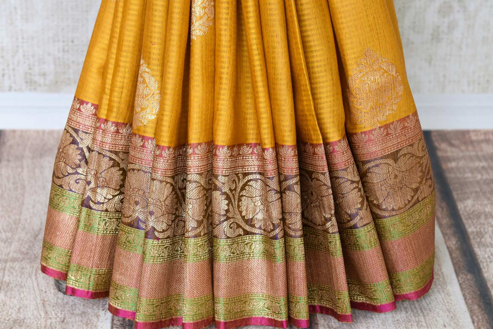Drape the gorgeousness of this yellow tussar banarsi silk saree to special occasions. It comes with a pretty buta work all over and glorious handloom work on the border. Style it with a designer multicolour threadwork blouse. Shop such handloom sari, banarsi silk saree online or visit Pure Elegance store, USA. -pleats