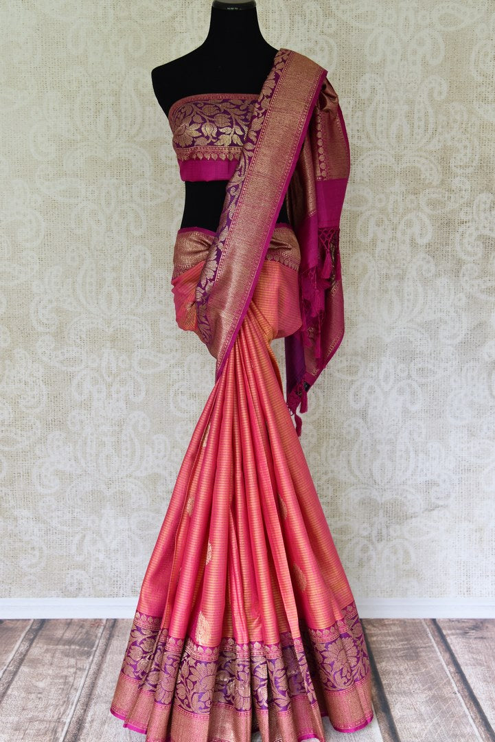 Shop orange pink tussar Banarasi sari with zari border online in USA. If you are heading to an Indian wedding and all you want is a rich traditional style then look no further than Pure Elegance Indian fashion store in USA. We have an exclusive range of Indian designer saris, traditional Banarasi sarees, silk saris and much more.-full view