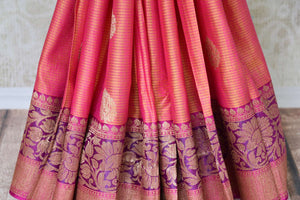 Shop orange pink tussar Banarasi sari with zari border online in USA. If you are heading to an Indian wedding and all you want is a rich traditional style then look no further than Pure Elegance Indian fashion store in USA. We have an exclusive range of Indian designer saris, traditional Banarasi sarees, silk saris and much more.-pleats