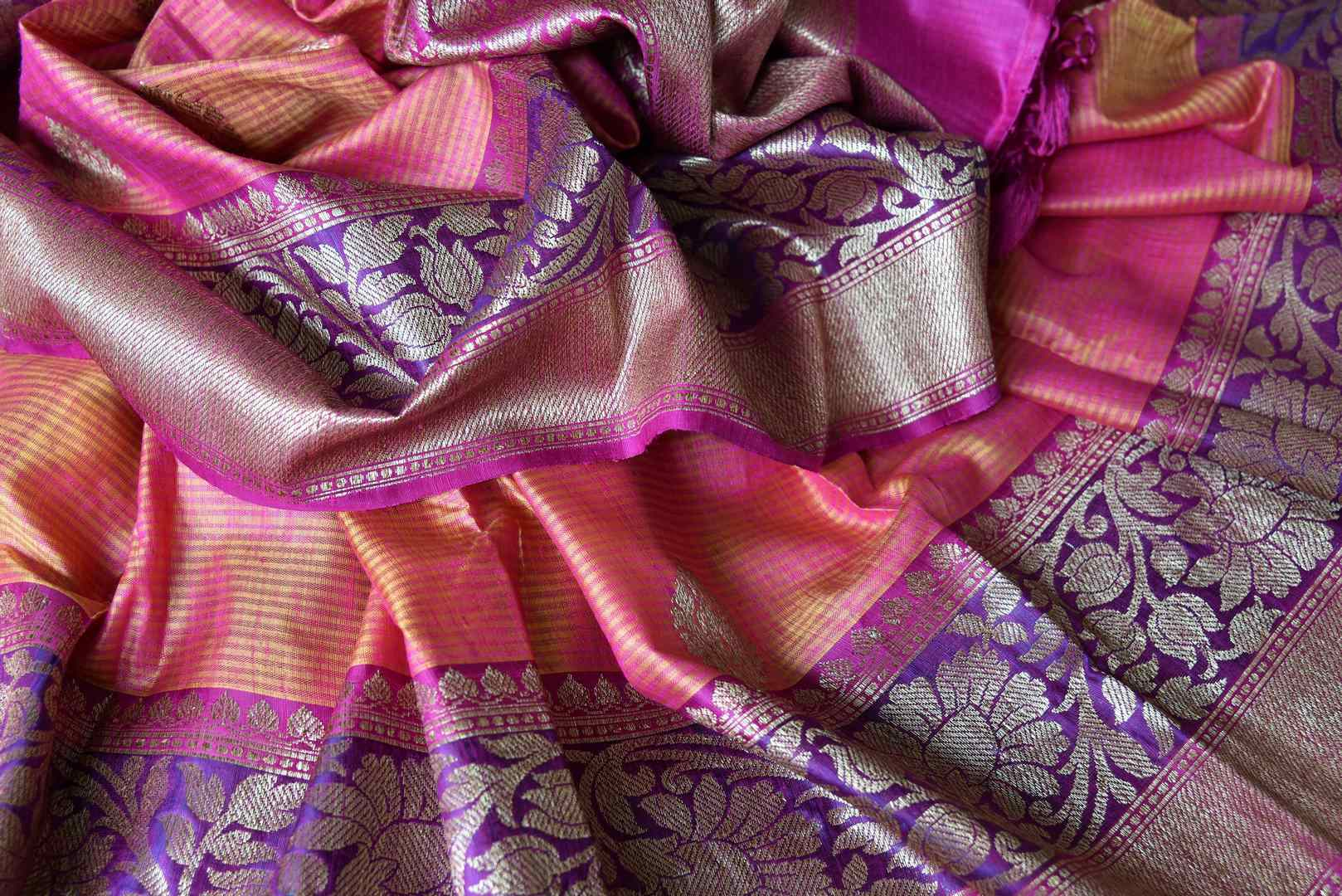Shop orange pink tussar Banarasi sari with zari border online in USA. If you are heading to an Indian wedding and all you want is a rich traditional style then look no further than Pure Elegance Indian fashion store in USA. We have an exclusive range of Indian designer saris, traditional Banarasi sarees, silk saris and much more.-details