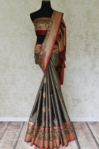 Buy grey tussar Banarasi sari online in USA with zari border and buta. Add elegance to your Indian wedding look with handwoven Indian Banarasi sarees available at Pure Elegance exclusive Indian clothing store in USA or browse through our website and shop online.-full view