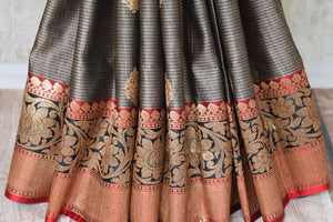 Buy grey tussar Banarasi sari online in USA with zari border and buta. Add elegance to your Indian wedding look with handwoven Indian Banarasi sarees available at Pure Elegance exclusive Indian clothing store in USA or browse through our website and shop online.-pleats