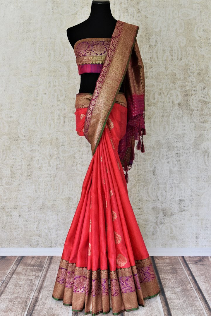 Buy pink tussar Banarasi saree online in USA with purple zari border and buta. Add brilliance to your Indian wedding look with handwoven Indian Banarasi sarees available at Pure Elegance exclusive Indian clothing store in USA or browse through our website and shop online.-full view