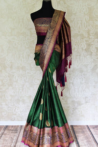 Buy bottle green tussar Banarasi saree with zari border online in USA. If you are heading to an Indian wedding and all you want is a rich traditional style then look no further than Pure Elegance Indian fashion store in USA. We have an exclusive range of Indian designer saris, traditional Banarasi sarees, handloom saris and much more.-full view