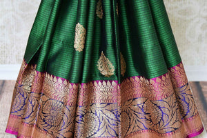 Buy bottle green tussar Banarasi saree with zari border online in USA. If you are heading to an Indian wedding and all you want is a rich traditional style then look no further than Pure Elegance Indian fashion store in USA. We have an exclusive range of Indian designer saris, traditional Banarasi sarees, handloom saris and much more.-pleats