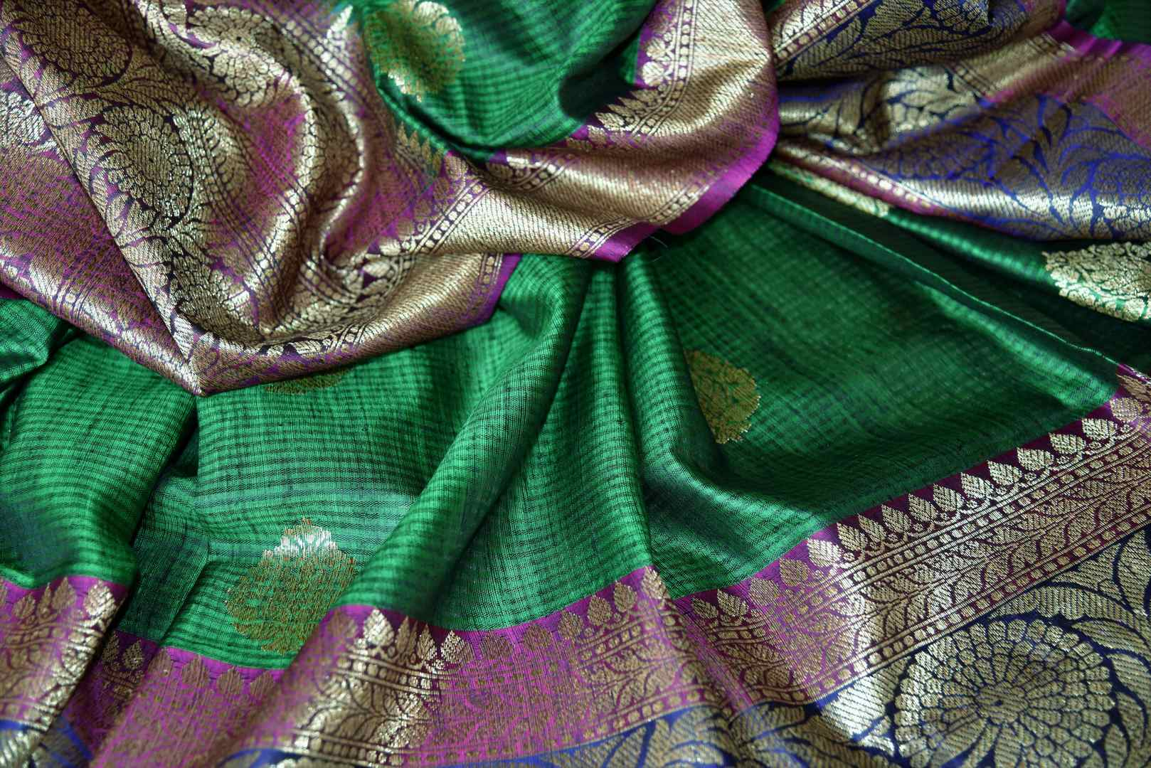Buy bottle green tussar Banarasi saree with zari border online in USA. If you are heading to an Indian wedding and all you want is a rich traditional style then look no further than Pure Elegance Indian fashion store in USA. We have an exclusive range of Indian designer saris, traditional Banarasi sarees, handloom saris and much more.-details