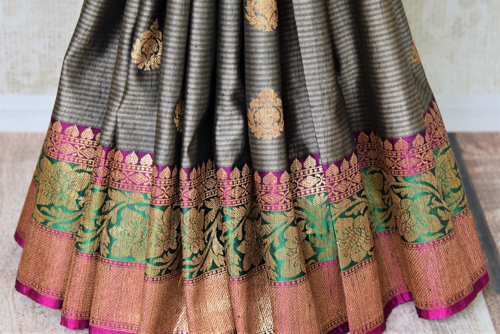 Buy grey striped tussar Banarasi saree online in USA with colorful zari border and buta. Add brilliance to your Indian wedding look with traditional Indian Banarasi saris available at Pure Elegance exclusive Indian clothing store in USA or browse through our website and shop online.-pleats