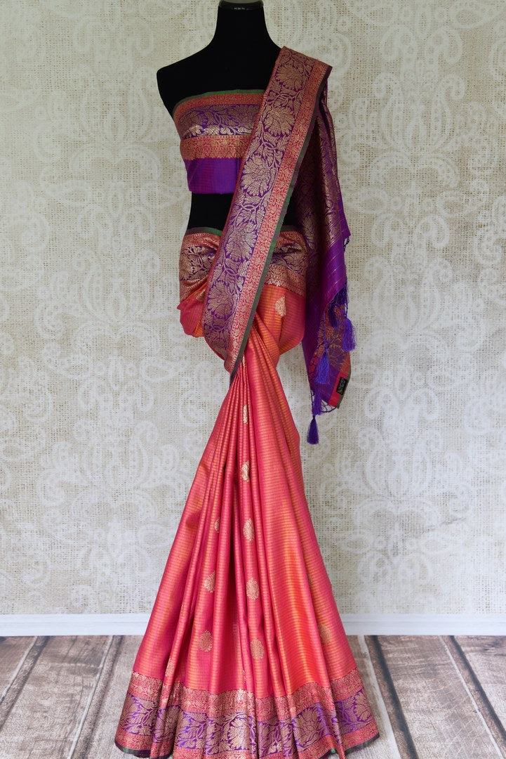 Buy bright orange pink tussar Banarasi saree with zari border online in USA. If you are heading to an Indian wedding and all you want is a rich traditional style then look no further than Pure Elegance Indian fashion store in USA. We have an exclusive range of Indian designer saris, traditional Banarasi sarees and much....-full view