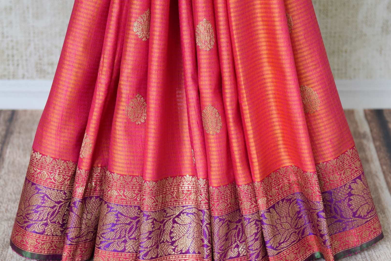 Buy bright orange pink tussar Banarasi saree with zari border online in USA. If you are heading to an Indian wedding and all you want is a rich traditional style then look no further than Pure Elegance Indian fashion store in USA. We have an exclusive range of Indian designer saris, traditional Banarasi sarees and much....-pleats