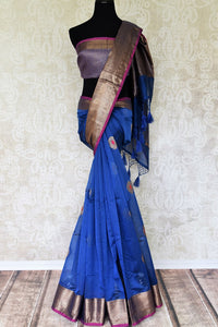 Unfold your glorious self in our blue chanderi silk buta work saree. It features buta work all-over and is styled with a contrasting zari weave blouse. Sashay at weddings or parties in this statement-worthy sari to steal the spotlight. Shop designer silk sari, printed saree online or visit Pure Elegance store, USA. -full view