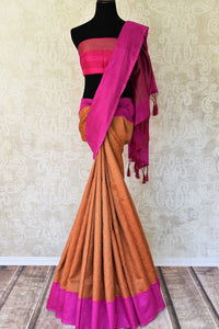 Buy bright orange tussar Banarasi saree with pink border online in USA. If you are heading to a special occasion and all you want is a rich traditional style then look no further than Pure Elegance Indian clothing store in USA. We have an exclusive range of Indian designer sarees, traditional Banarasi sarees and much....-full view