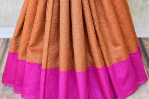 Buy bright orange tussar Banarasi saree with pink border online in USA. If you are heading to a special occasion and all you want is a rich traditional style then look no further than Pure Elegance Indian clothing store in USA. We have an exclusive range of Indian designer sarees, traditional Banarasi sarees and much....-pleats
