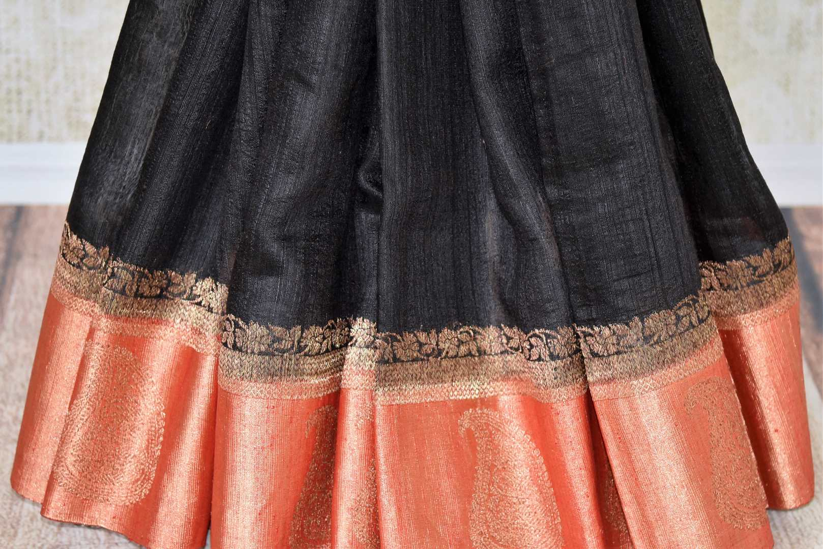 Buy black tussar Benarasi sari online in USA with red zari border and pallu. Make an elegant ethnic fashion statement at parties, weddings and special occasions with a splendid collection of Indian designer sarees, Banarasi saris, handloom saris from Pure Elegance Indian clothing store in USA or shop online.-pleats