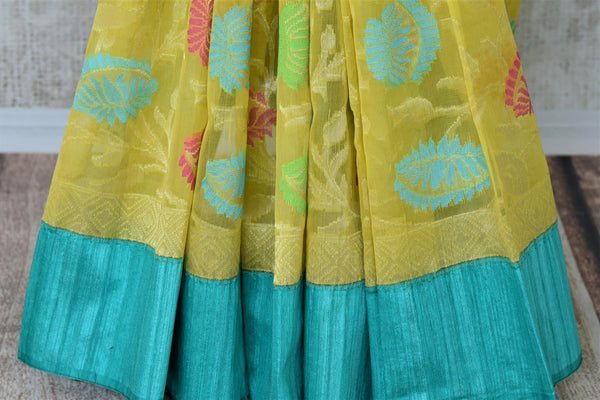 Buy yellow organza Banarasi saree online in USA with colorful floral design. Add brilliance to your Indian ethnic look with traditional Indian Banarasi saris available at Pure Elegance exclusive Indian clothing store in USA or browse through our website and shop online.-pleats