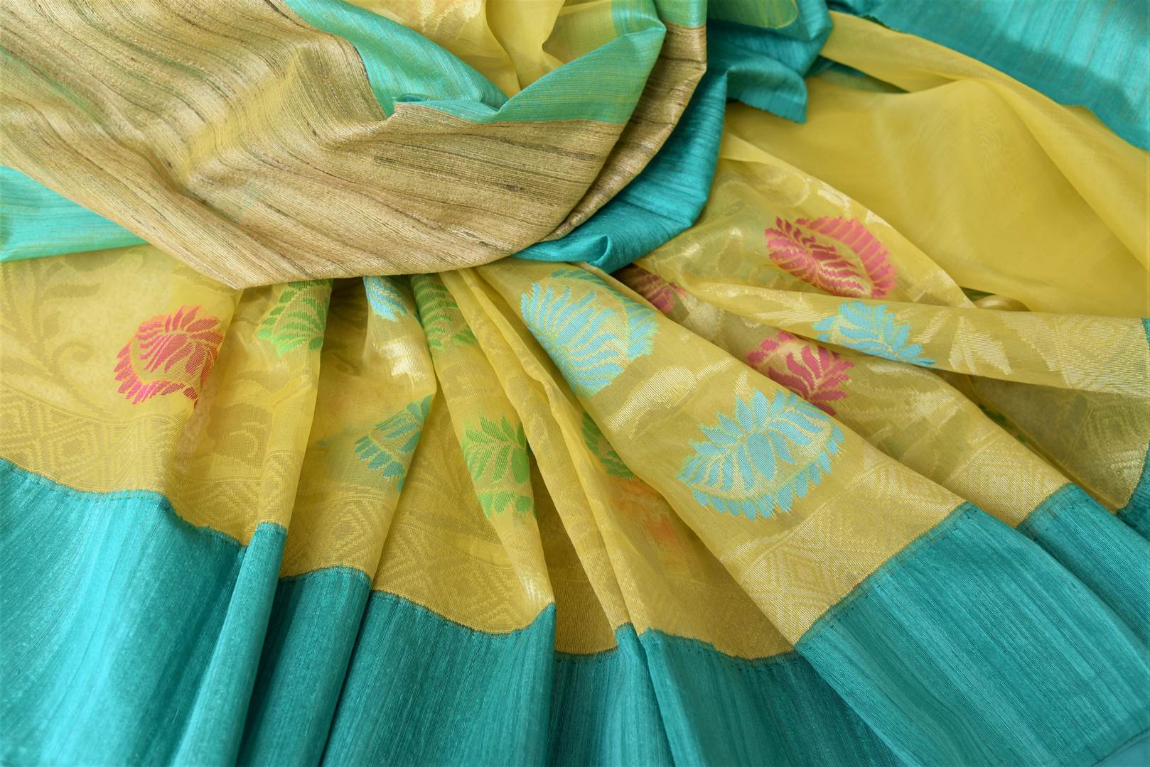 Buy yellow organza Banarasi saree online in USA with colorful floral design. Add brilliance to your Indian ethnic look with traditional Indian Banarasi saris available at Pure Elegance exclusive Indian clothing store in USA or browse through our website and shop online.-details
