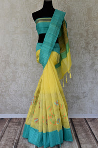 Buy beautiful yellow organza Banarasi saree online in USA with blue border. Add brilliance to your Indian ethnic look with woven Indian Banarasi saris available at Pure Elegance exclusive Indian clothing store in USA or browse through our website and shop online.-full view