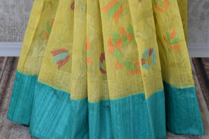 Buy beautiful yellow organza Banarasi saree online in USA with blue border. Add brilliance to your Indian ethnic look with woven Indian Banarasi saris available at Pure Elegance exclusive Indian clothing store in USA or browse through our website and shop online.-pleats