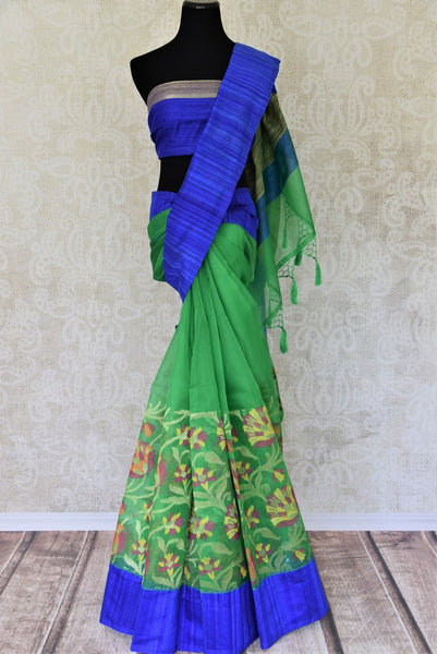 Buy beautiful green organza Banarasi saree online in USA with floral jaal border. Add brilliance to your Indian ethnic look with woven Indian Banarasi saris available at Pure Elegance exclusive Indian clothing store in USA or browse through our website and shop online.-full view