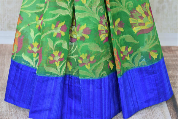 Buy beautiful green organza Banarasi saree online in USA with floral jaal border. Add brilliance to your Indian ethnic look with woven Indian Banarasi saris available at Pure Elegance exclusive Indian clothing store in USA or browse through our website and shop online.-pleats