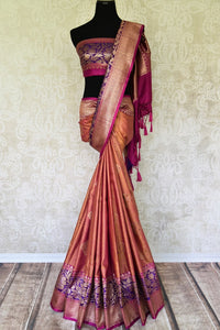 Ace your uber-style in this pink tussar banarsi silk sari. Style it with a designer blouse and intricate buta work all-over the beautiful saree. The rich gold zari border saree that comes with a breath-taking contrast. Shop handloom sarees, banarsi silk sari, chiffon saree online or visit Pure Elegance store, USA. -full view