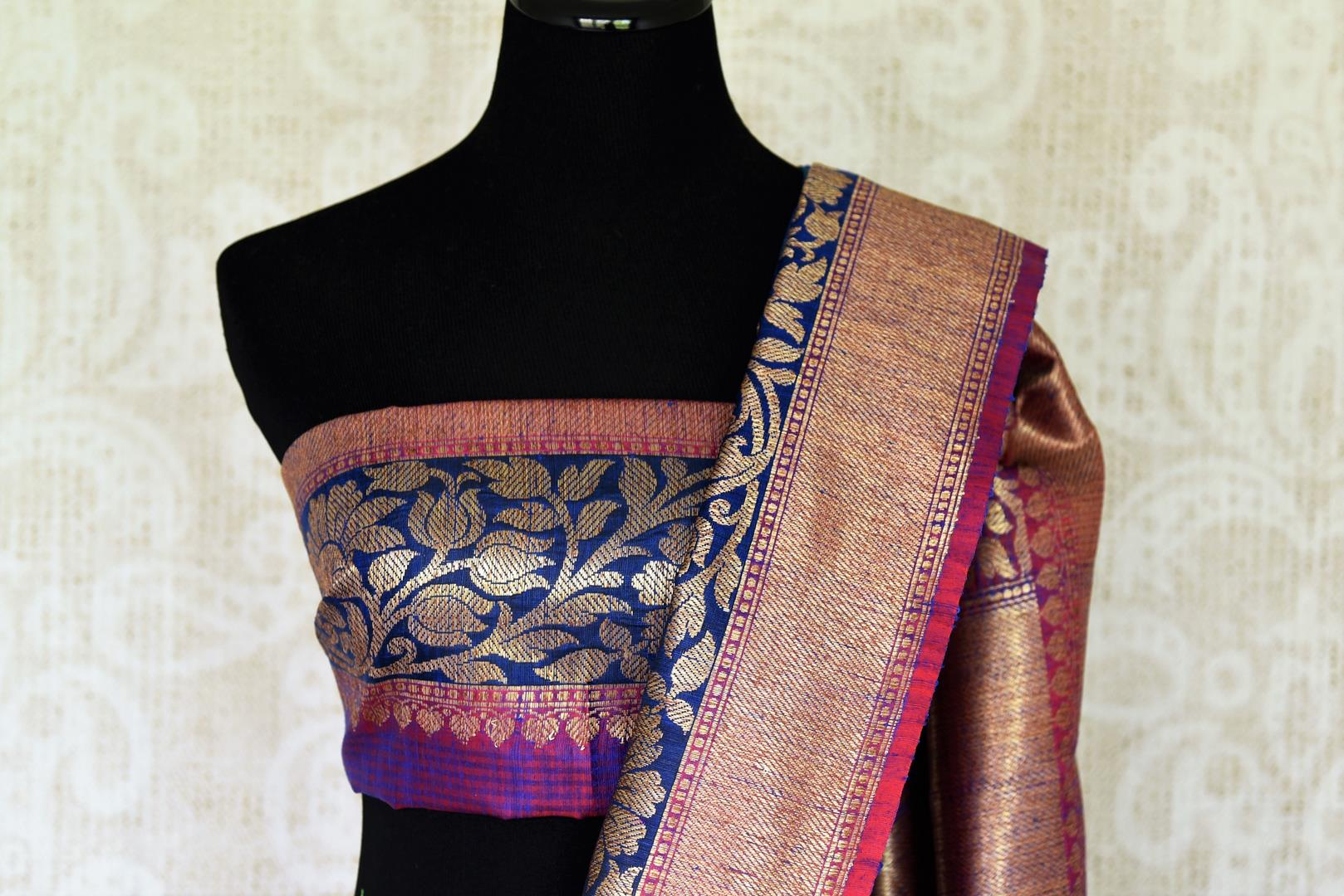 Indulge in the ethereal beauty of this royal blue tussar banarsi silk saree which comes with buta work and zari border. Style it with a designer blouse and steal the limelight as you sashay in a heavily embroidered pallu. Shop handloom sarees, georgette sari, ikkat saree online or visit Pure Elegance store, USA. -blouse pallu