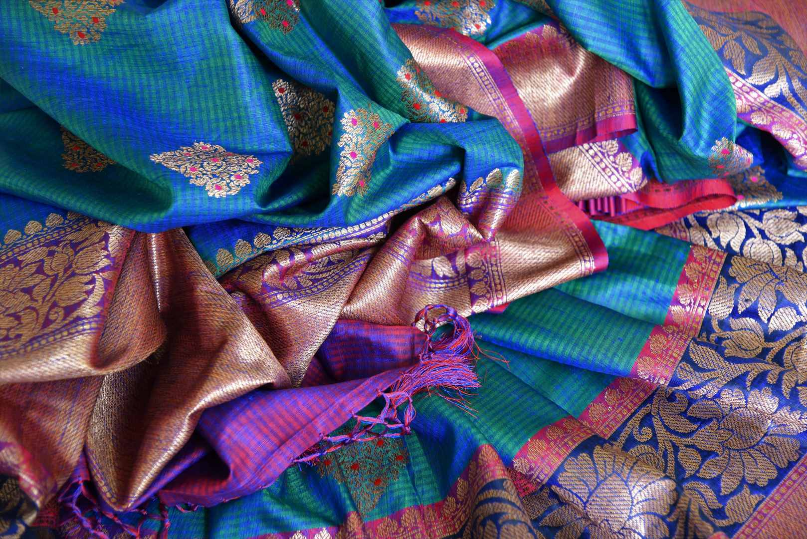 Indulge in the ethereal beauty of this royal blue tussar banarsi silk saree which comes with buta work and zari border. Style it with a designer blouse and steal the limelight as you sashay in a heavily embroidered pallu. Shop handloom sarees, georgette sari, ikkat saree online or visit Pure Elegance store, USA. -details