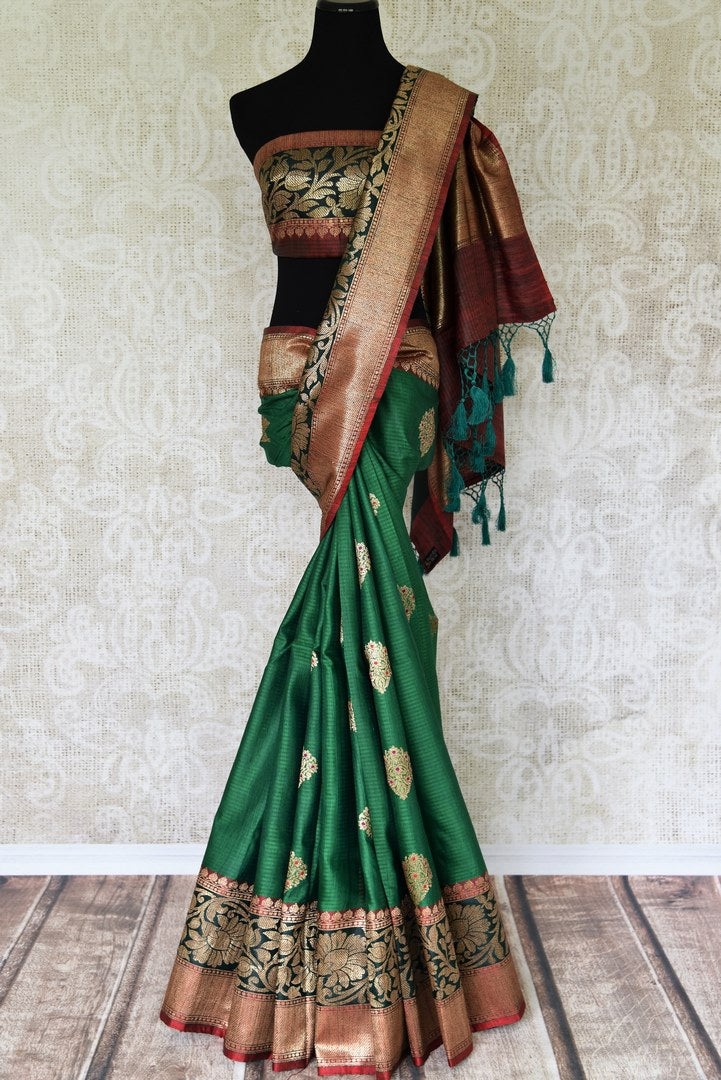 Flaunt your traditional side with our green tussar banarsi silk saree that features gorgeous buta work and intricately handwoven pallu. It blends perfectly with a muted woven designer blouse to ooze the elegance. Shop handloom sarees, linen sari, chiffon sari online or visit Pure Elegance store, USA.-full view