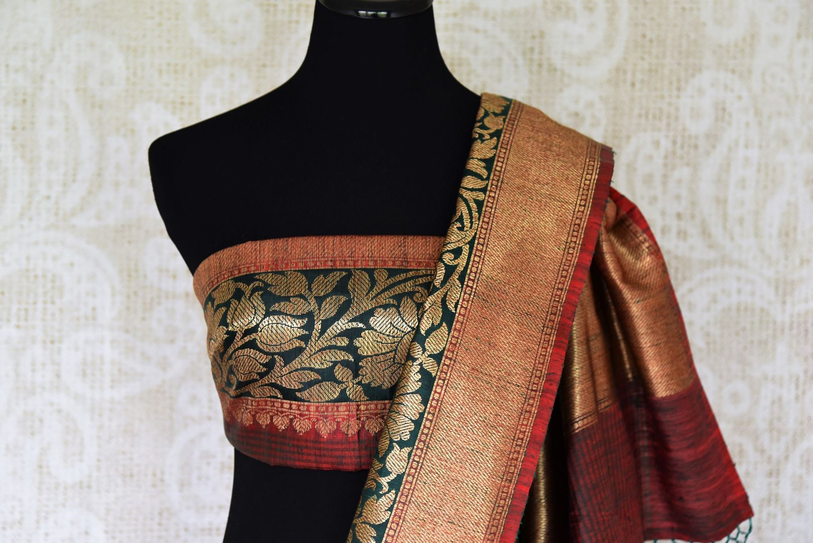 Flaunt your traditional side with our green tussar banarsi silk saree that features gorgeous buta work and intricately handwoven pallu. It blends perfectly with a muted woven designer blouse to ooze the elegance. Shop handloom sarees, linen sari, chiffon sari online or visit Pure Elegance store, USA.-blouse pallu