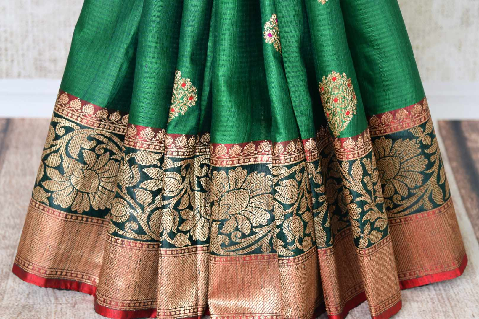 Flaunt your traditional side with our green tussar banarsi silk saree that features gorgeous buta work and intricately handwoven pallu. It blends perfectly with a muted woven designer blouse to ooze the elegance. Shop handloom sarees, linen sari, chiffon sari online or visit Pure Elegance store, USA.-pleats
