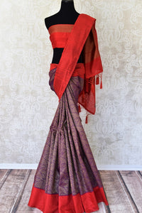 Buy traditional purple tussar Banarasi sari with red border online in USA. If you are heading to a special occasion and all you want is a rich traditional style then look no further than Pure Elegance Indian clothing store in USA. We have an exclusive range of Indian designer sarees, traditional handloom sarees and much....-full view