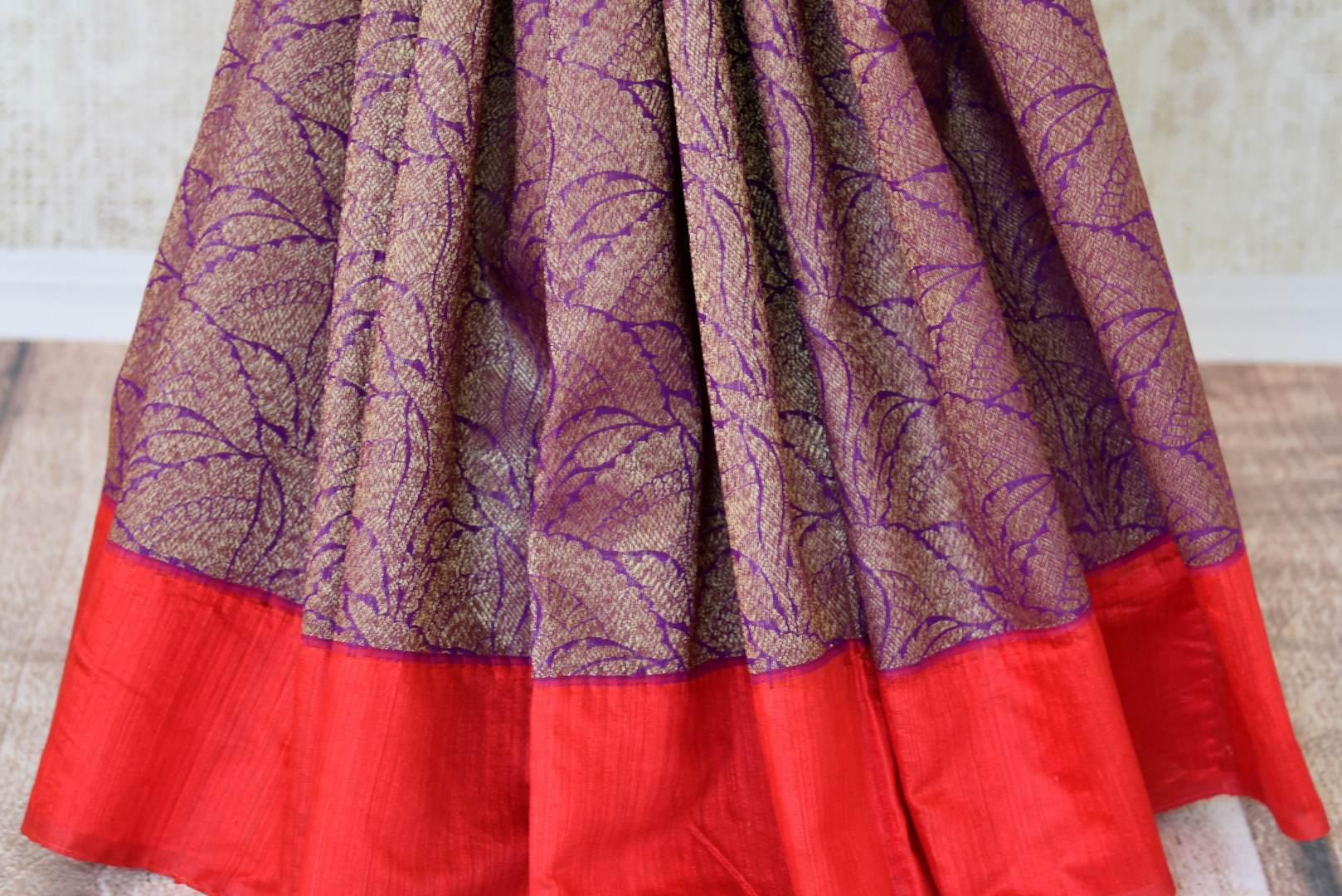 Buy traditional purple tussar Banarasi sari with red border online in USA. If you are heading to a special occasion and all you want is a rich traditional style then look no further than Pure Elegance Indian clothing store in USA. We have an exclusive range of Indian designer sarees, traditional handloom sarees and much....-pleats