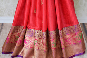 Buy bright pink tussar Banarasi sari with zari border online in USA. Adorn yourself in glorious Indian clothing from Pure Elegance Indian clothing store in USA. We have an exclusive range of Indian designer sarees, traditional handloom sarees, Banarasi sarees to make your Indian look absolutely captivating.-pleats