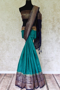 Accentuate your beauty with this exclusively designed mint green matka banarsi silk saree. It comes with a gorgeous zari handwoven border and a contrasting royal blue zari blouse. Complement the sari with pearl jewelry. Shop designer banarsi silk sari, organza saree, linen sari online or visit Pure Elegance store, USA.-full view