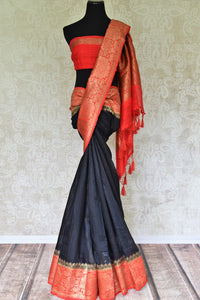 Enhance the subtle charm with classic black matka banarsi silk saree which comes with a vibrant red zari border. Strut to social events in this ensemble. Style it with a gorgeous red zari blouse to turn heads. Shop handloom sarees, kanjeevaram silk sari, linen sari online or visit Pure Elegance store, USA. -full view