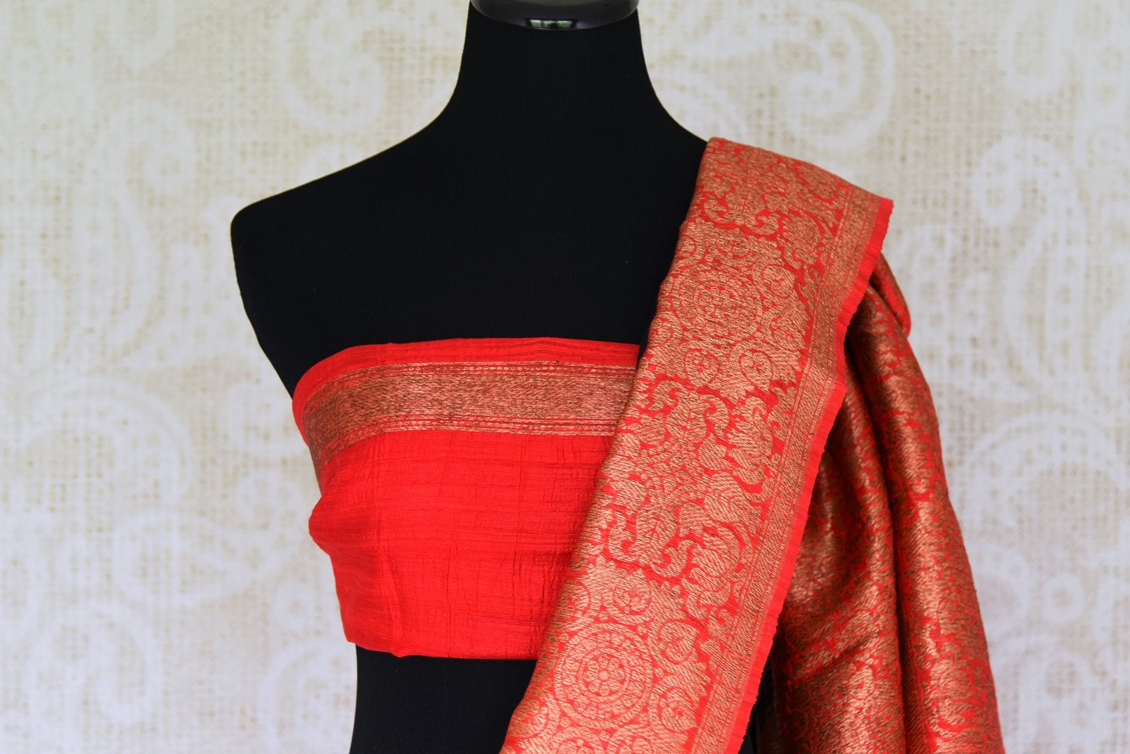 Enhance the subtle charm with classic black matka banarsi silk saree which comes with a vibrant red zari border. Strut to social events in this ensemble. Style it with a gorgeous red zari blouse to turn heads. Shop handloom sarees, kanjeevaram silk sari, linen sari online or visit Pure Elegance store, USA. -blouse pallu