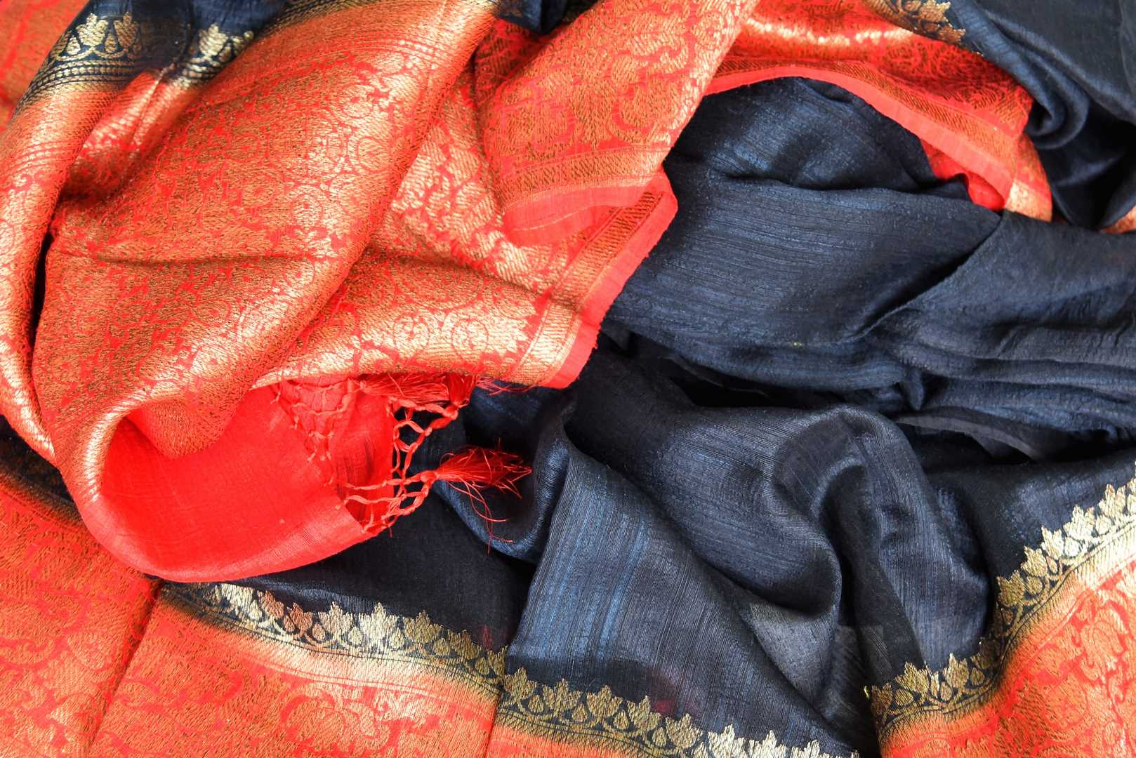 Enhance the subtle charm with classic black matka banarsi silk saree which comes with a vibrant red zari border. Strut to social events in this ensemble. Style it with a gorgeous red zari blouse to turn heads. Shop handloom sarees, kanjeevaram silk sari, linen sari online or visit Pure Elegance store, USA. -details