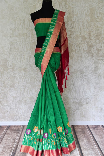 Buy green tussar Benarasi saree online in USA with floral design and zari border. Make an elegant ethnic fashion statement at parties, weddings and special occasions with a splendid collection of Indian designer sarees, Benarasi saris, Indian clothing from Pure Elegance Indian clothing store in USA or shop online.-full view