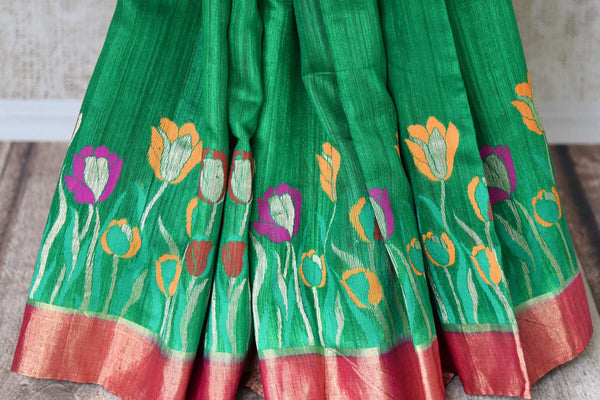 Buy green tussar Benarasi saree online in USA with floral design and zari border. Make an elegant ethnic fashion statement at parties, weddings and special occasions with a splendid collection of Indian designer sarees, Benarasi saris, Indian clothing from Pure Elegance Indian clothing store in USA or shop online.-pleats