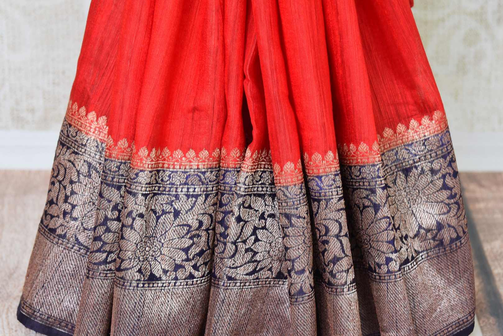 Enchanting hues of red matka banarsi silk are here to melt your heart this wedding season. Drape this sari with a gold and black intricately woven zari border and compliment it with a similar designer blouse. Shop handloom sarees, silk sari, linen saree online or visit Pure Elegance store, USA.-pleats