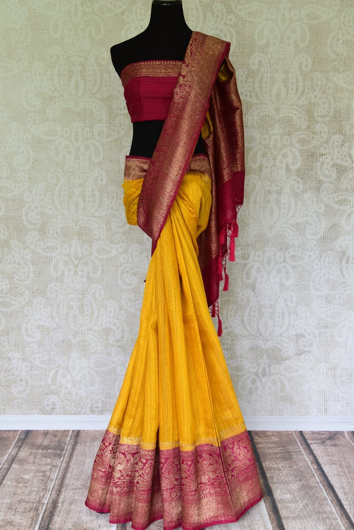 Shine bright like a sunshine in our vibrant yellow matka banarsi silk sari which is blended well with a pink zari border. Style this effervescent saree with a hot pink zari blouse to catch the fancy of folks around. Shop designer silk sarees, georgette sari, organza sari online or visit Pure Elegance store, USA.-full view