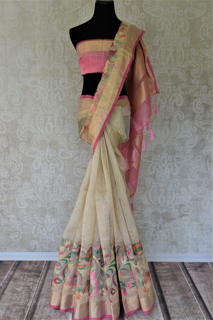 Buy cream chanderi Banarasi saree online in USA with zari border.. Shine with the beauty of woven Indian Banarasi saris available at Pure Elegance exclusive Indian fashion store in USA or browse through our website and shop online.-full view