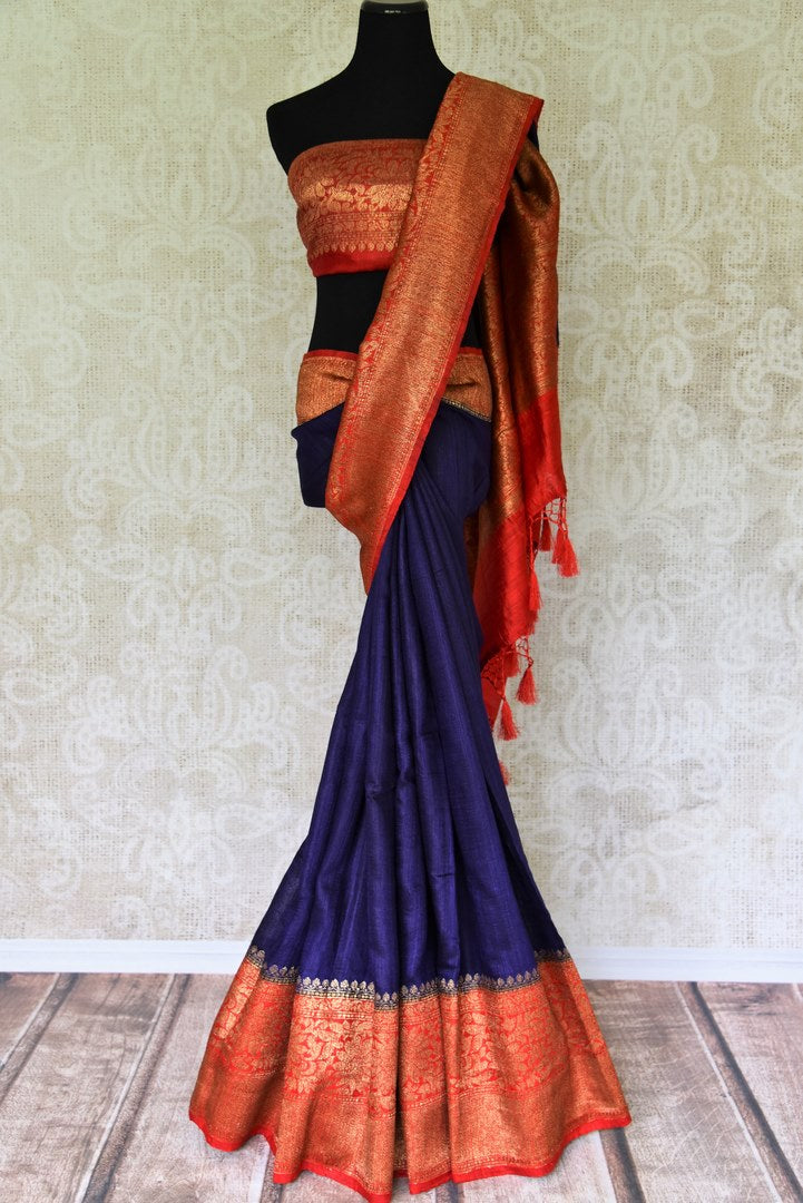 Up your stylish appeal in this royal blue matka banarsi silk saree with a graceful red zari border. Style this saree with a stunning bright red zari designer blouse complemented with a heavily woven pallu. Shop handloom sarees, linen sari, chiffon saree online or visit Pure Elegance store, USA.-full view
