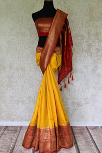 Exude a flair of elegance in this scintillating bright yellow matka banarsi silk saree. It comes with a gorgeous red zari border and complemented well with a contrasting red zari designer blouse. Shop handcrafted silk sarees, linen sari, georgette saree online or visit Pure Elegance store, USA.- full view