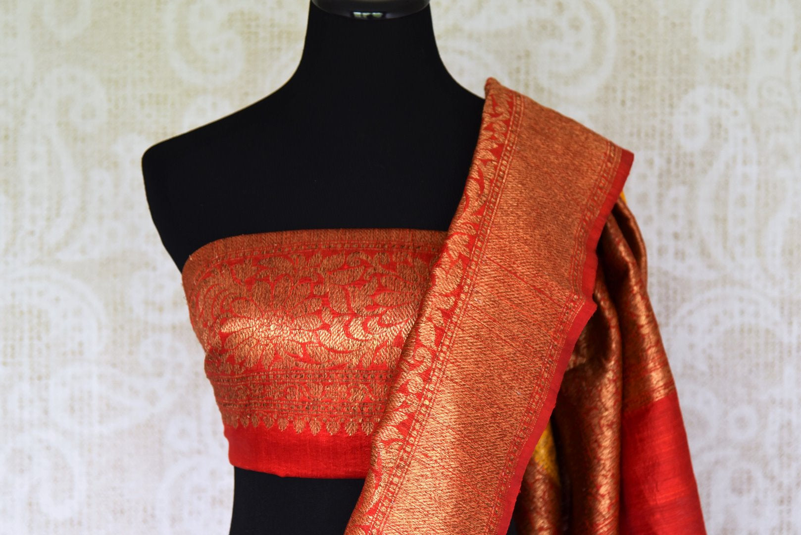 Exude a flair of elegance in this scintillating bright yellow matka banarsi silk saree. It comes with a gorgeous red zari border and complemented well with a contrasting red zari designer blouse. Shop handcrafted silk sarees, linen sari, georgette saree online or visit Pure Elegance store, USA.-blouse pallu